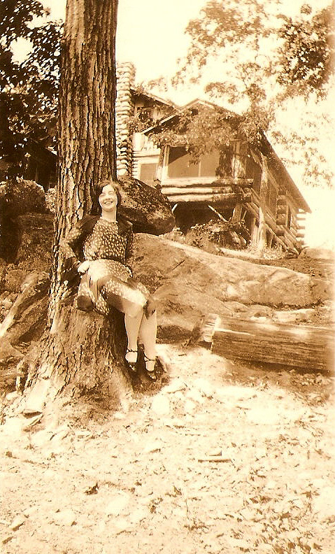 "My mom, about 17 and a very flashy dresser, standing in front of Eraho Lodge. In ""Clap Hands! Here Comes Charlie,"" that's about where the FBI agents would've concealed themselves, behind that tree and rock, as they fired their weapons at ""Mad Dog"" Lester M. TenEyck."