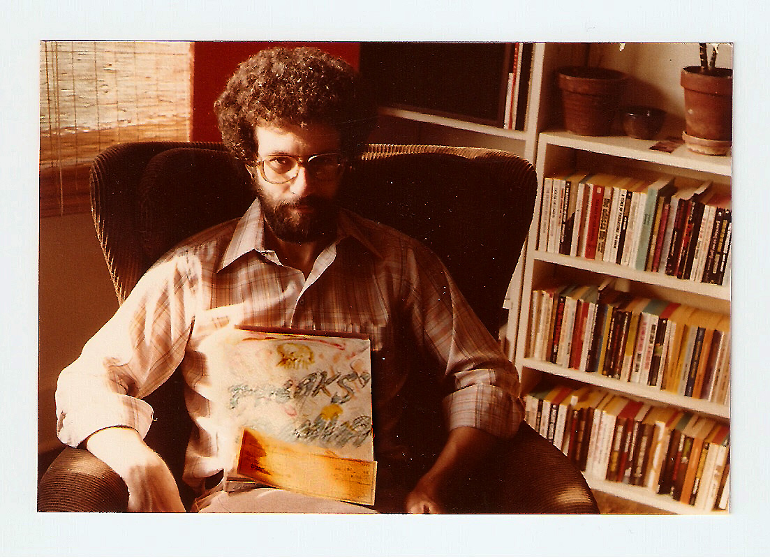 That's me, in September 1977 when I was 28, holding the check from William Morrow and Company for the first installment--$2500--of the $5000 advance for my debut novel, Freaks' Amour. The novel itself, which was far from finished at that time (I'd only written 100 pages), wouldn't be published for another year and a half. I don't know why I don't happy in the picture, I'm sure I was.