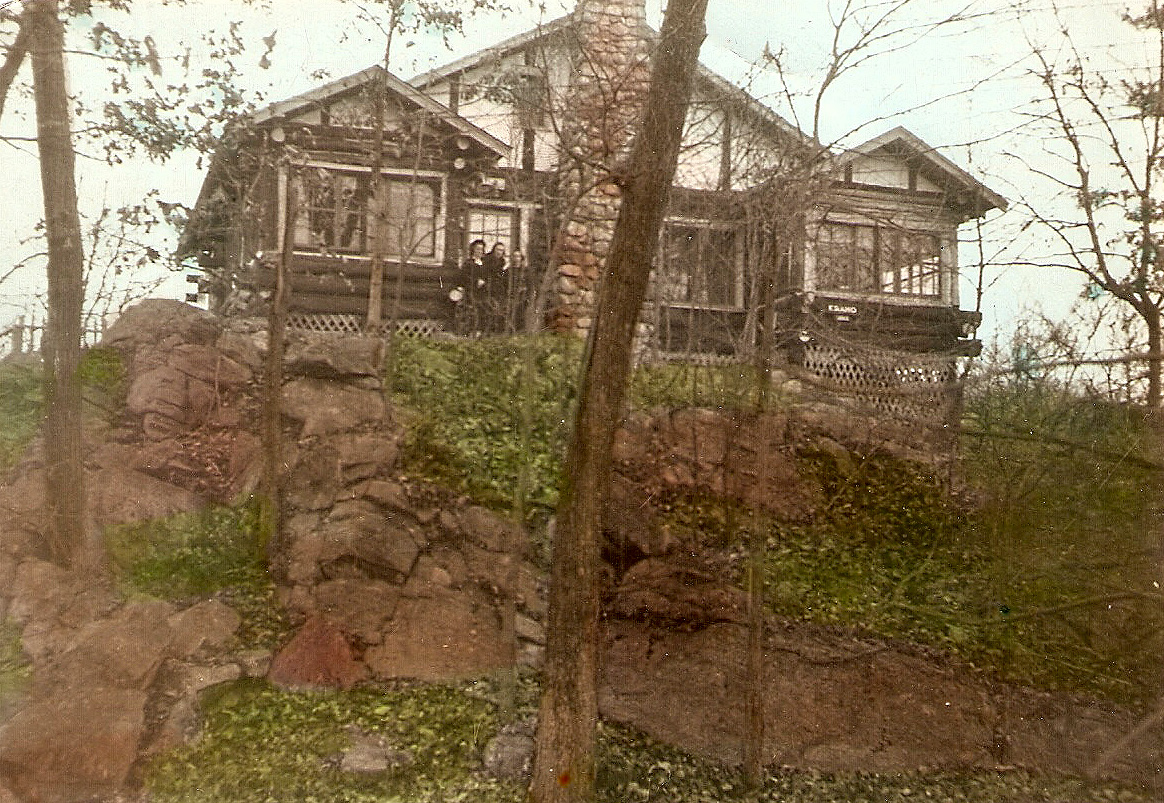 "Eraho Lodge, the second--the hilltop--house that my grandmother had built at Cranberry Lake. (The flagstone patio had yet to be added.) The photo probably was taken in the early 1930s. In the novella ""Clap Hands! Here Comes Charlie,"" the bank robber Lester M TenEyck holed up here, and in ""Where We'll Never Grow Old,"" Joy and her mother waited with her for the end of the world."