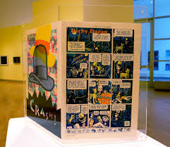 "In December 2013, Art Spiegelman's careeer retrospective, ""Co-Mix"" opened at the Jewish Museum in New York City, and along with the original dust jacket from Derby Dugan's Depression Funnies, on prominent display was a lithograph featuring imagery from the imaginary Derby Dugan newspaper strip and the Sunday page-frontispiece he'd done years before for my novel."